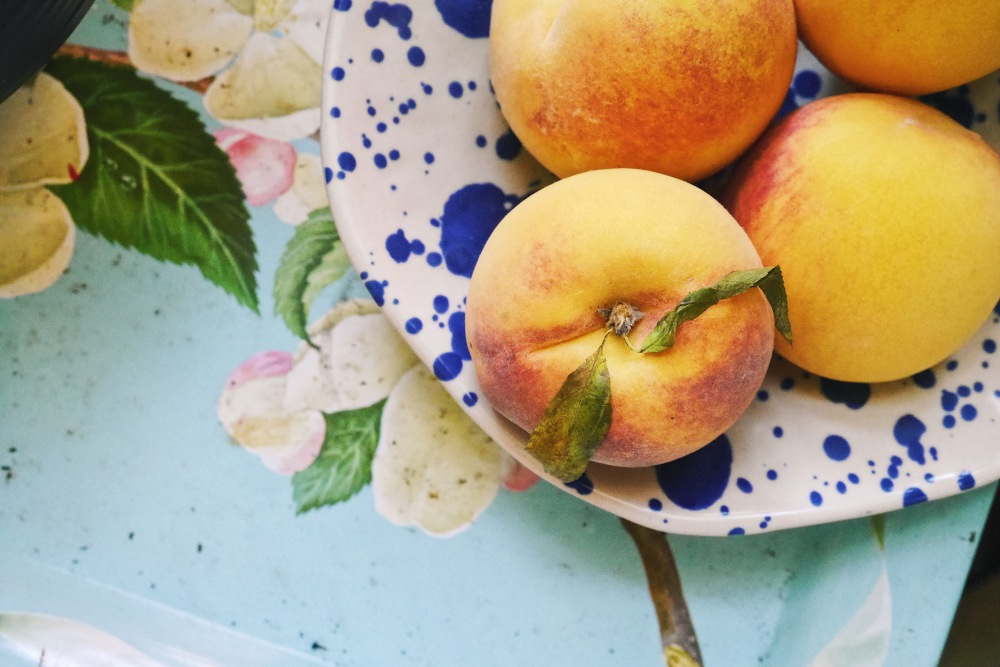 Ripe summer peach in a bowl