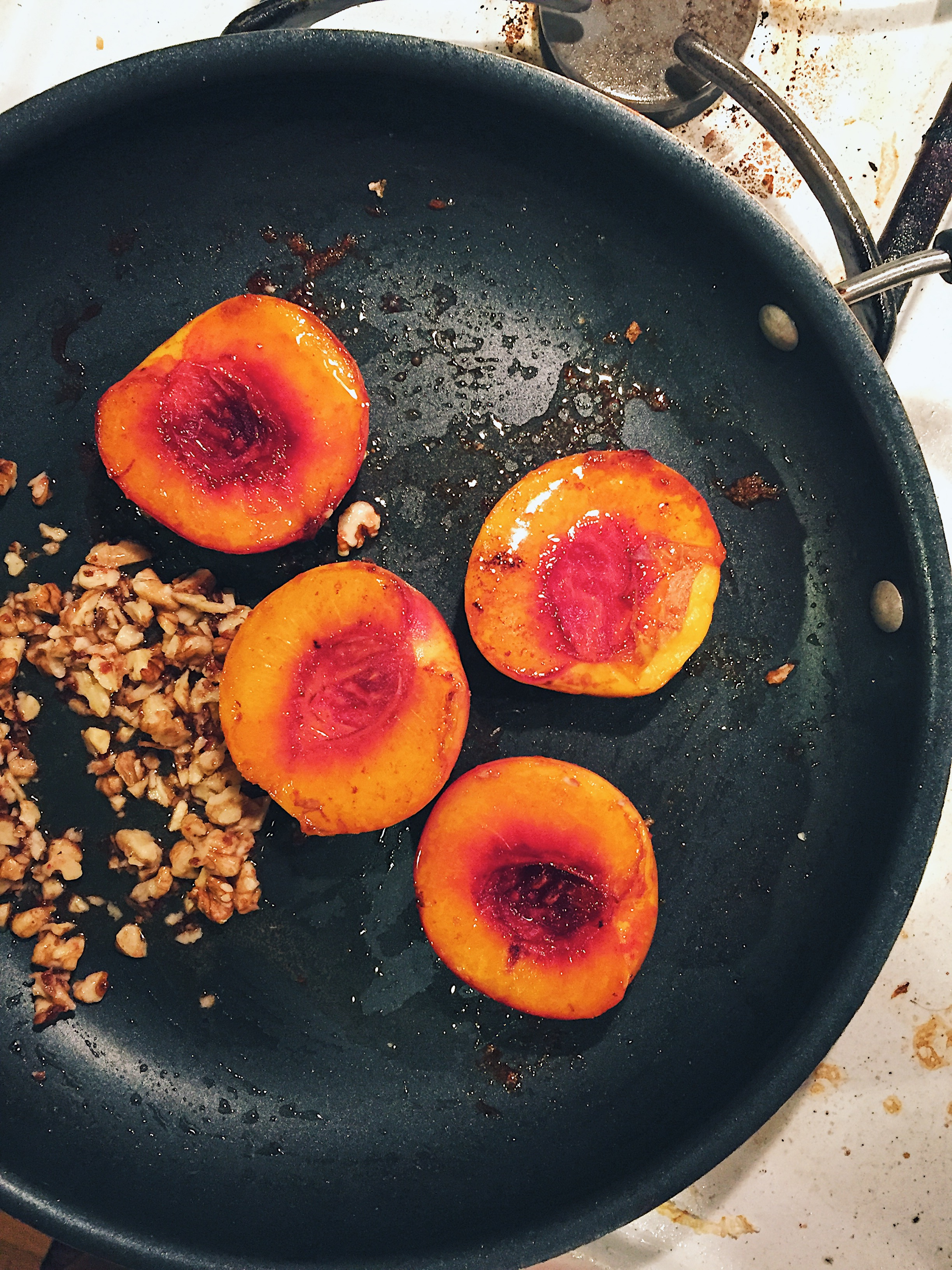butter poached peaches topped with walnuts